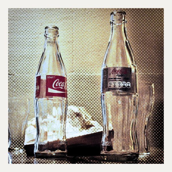 Two Coca-Cola bottles.