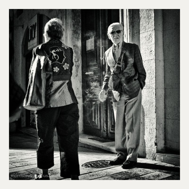 Man smoking in the street.