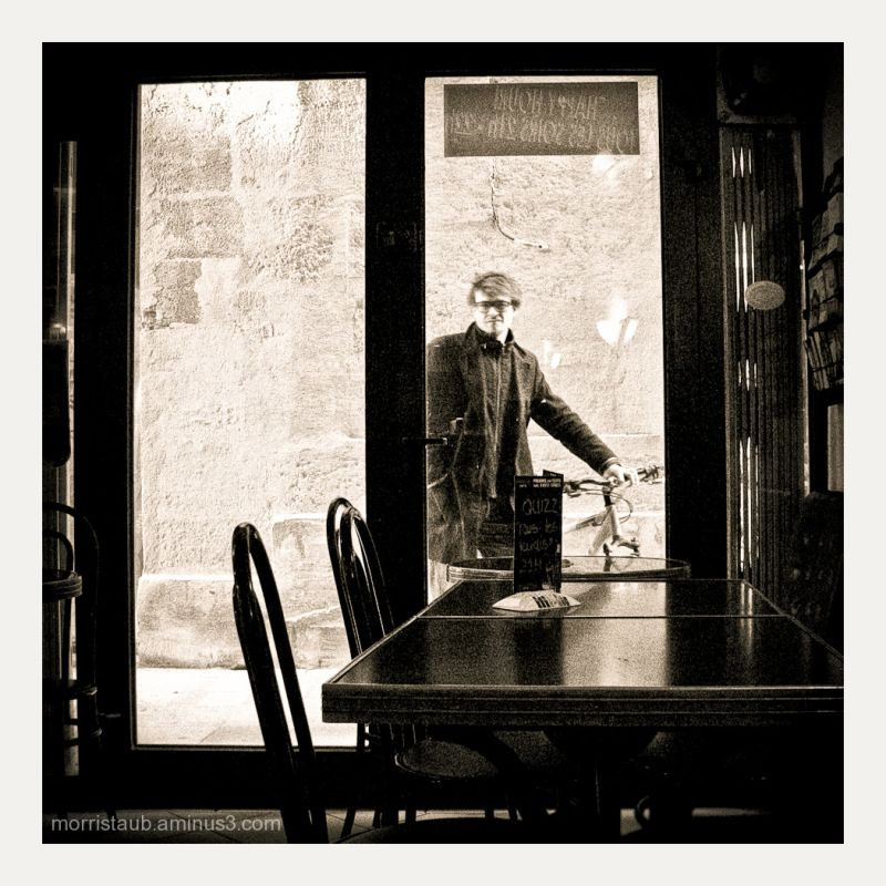 Man looking inside a cafe in France.