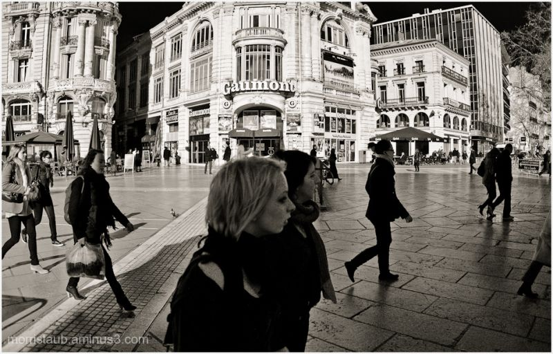 People walking in a large square in France.