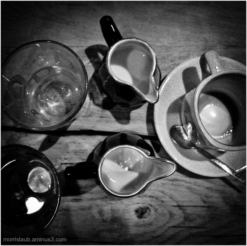 High perspective of cafe table with mugs, coffee.