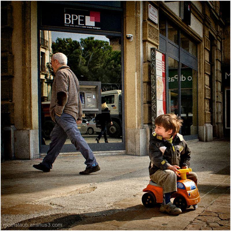 Child on toy bike in Montpellier.