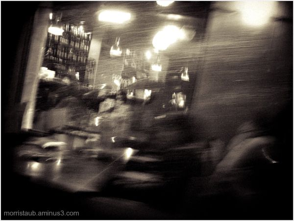 Blurred image of couple in a cafe at night.
