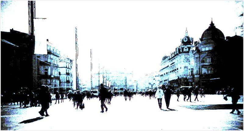People walking in a large square in Montpellier.