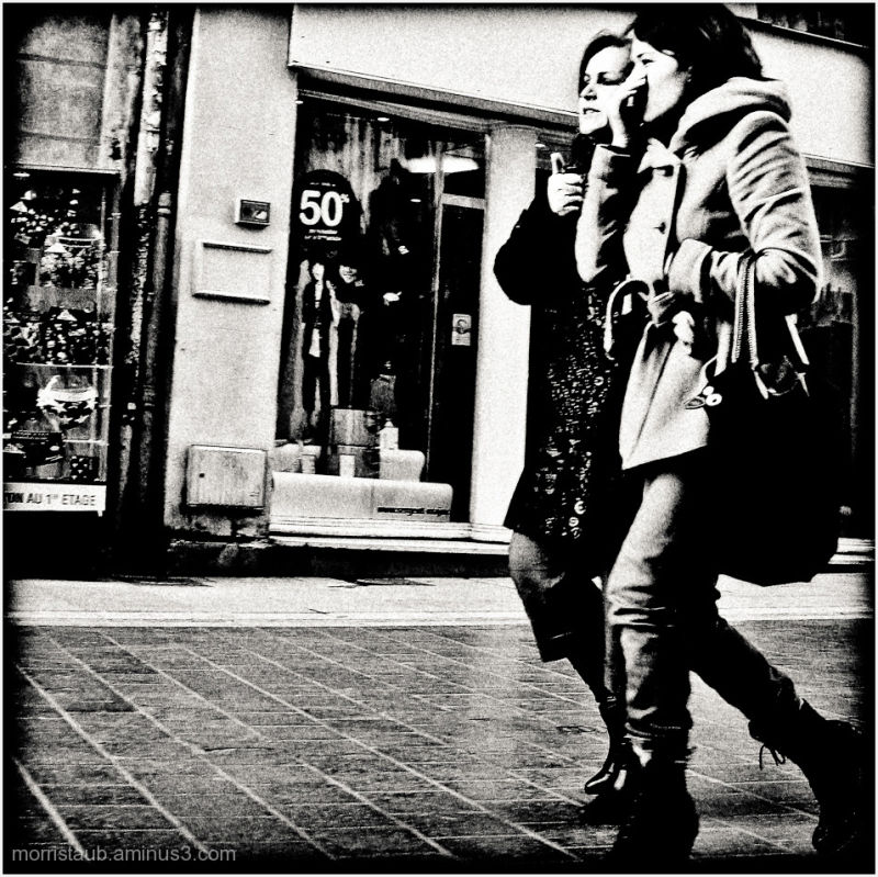 Two women walking and talking.