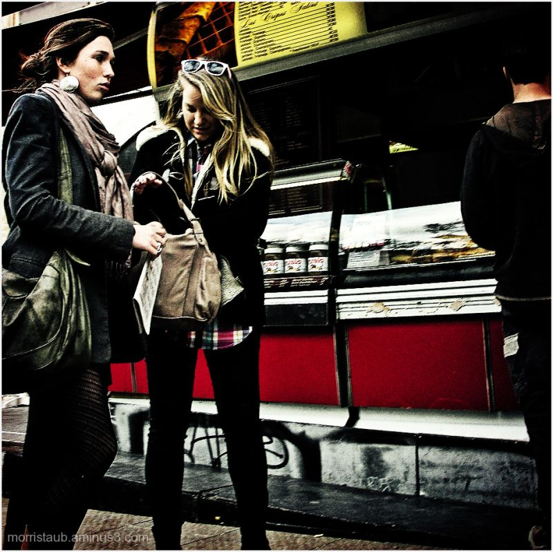 Two women waiting to buy fast food.