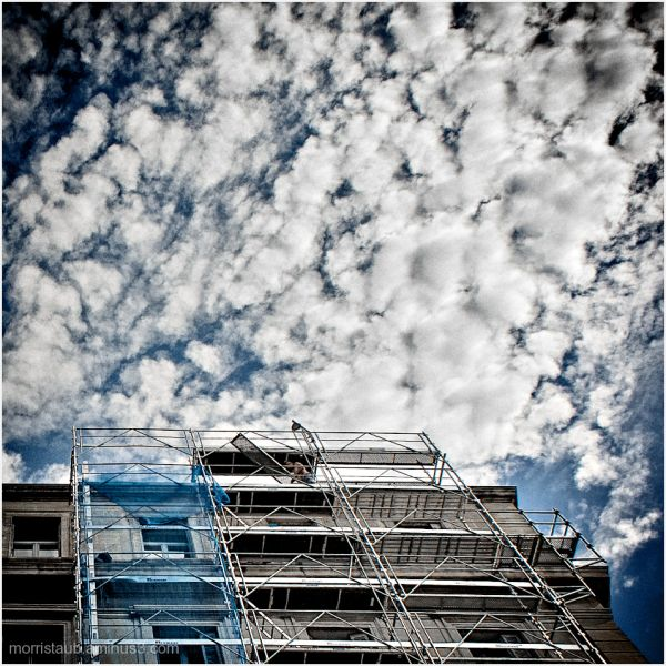Scaffold on building with big sky.