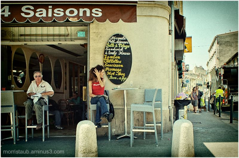 Two customers outside a cafe called the 4 Saisons.