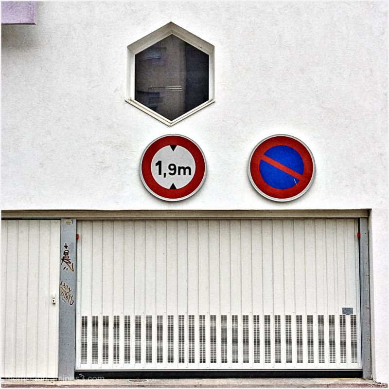 Garage door with height warning, no parking.