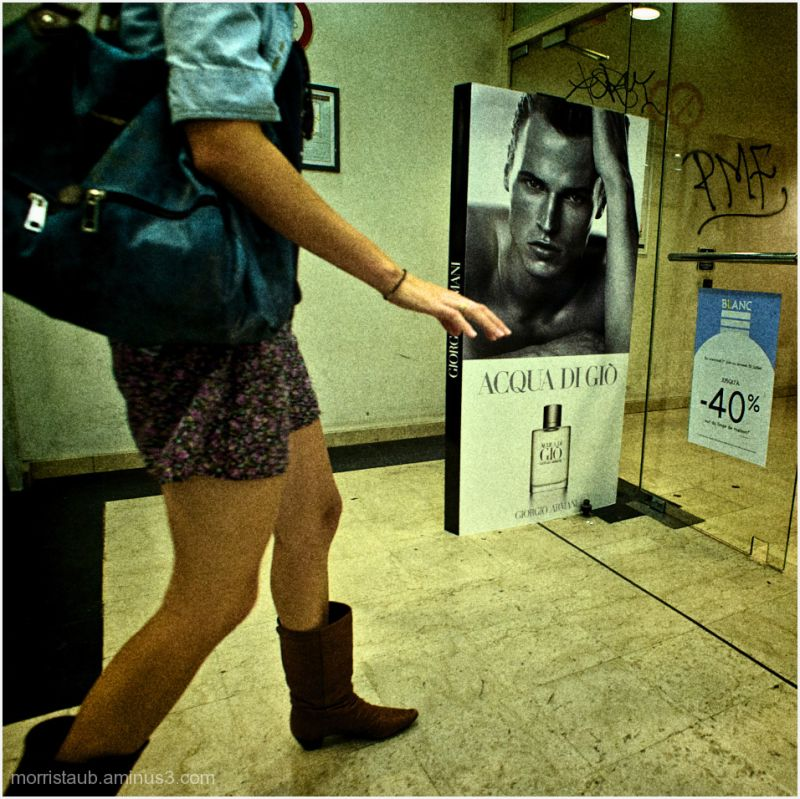 Woman and man in ad for perfume.