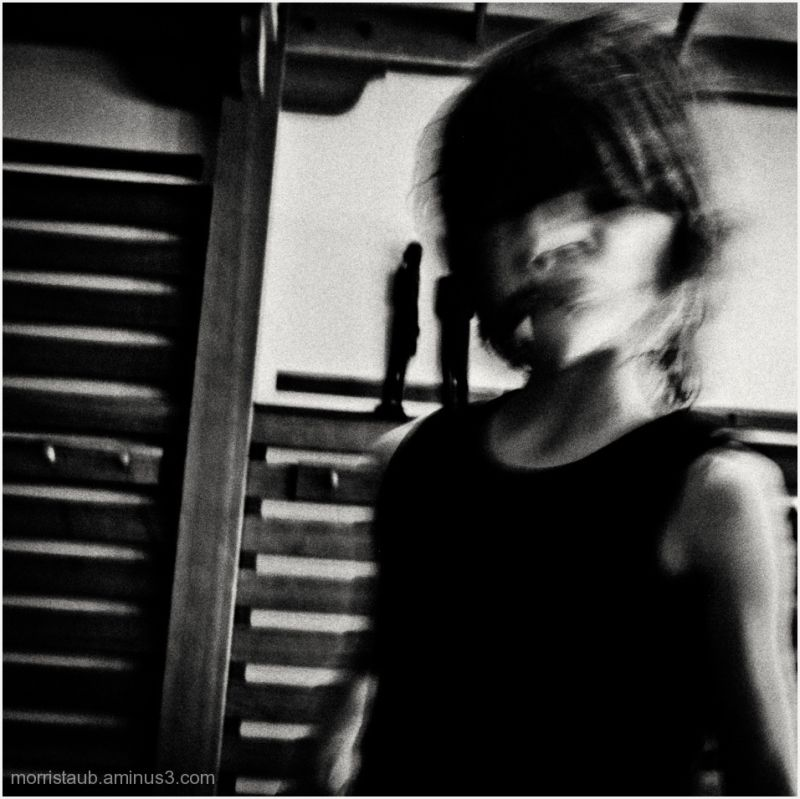 Black and white image of blurred boy.