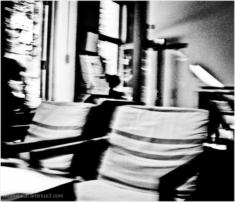 Cafe in b&w with blur and grain.