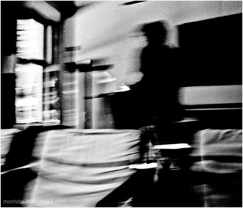 B&W of man in cafe.