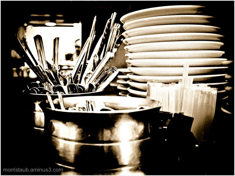 Dishes, silverware at a cafe.
