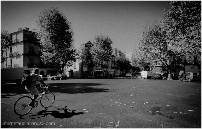 Man on bike in b&w.