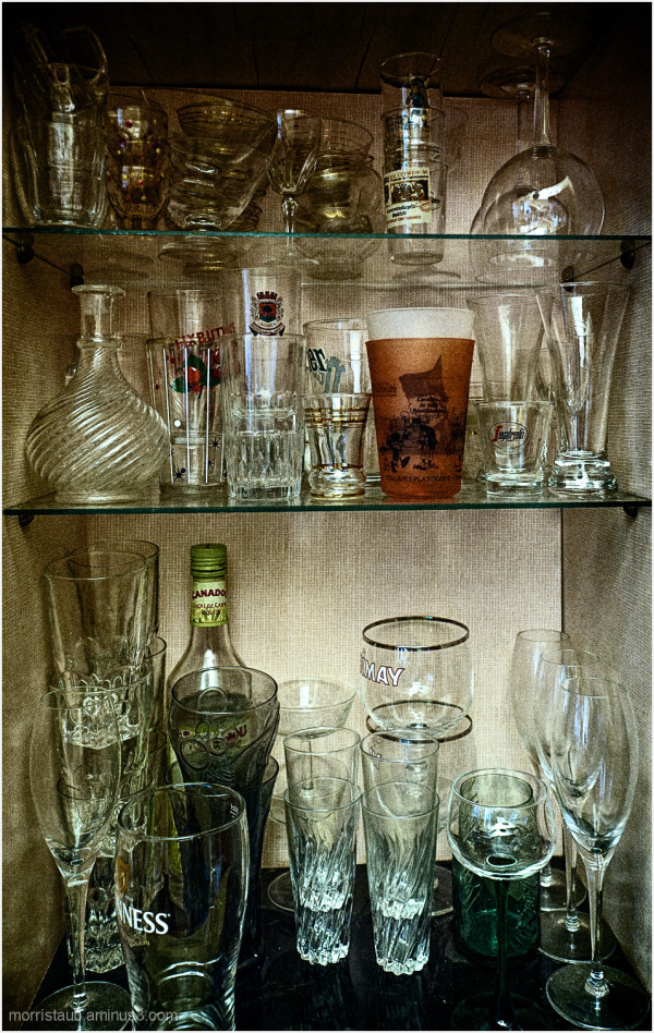 Cabinet full of glasses for wine and beer.
