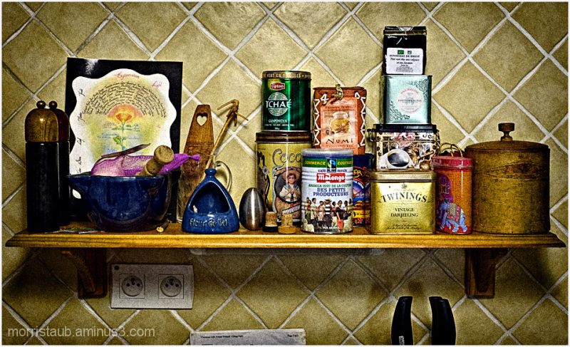 Kitchen shelf with tea, coffee, salt, pepper.