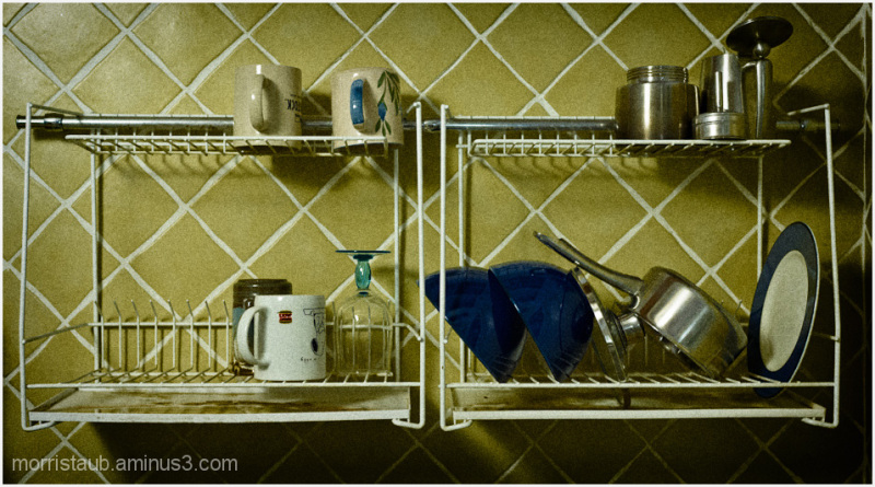 Kitchen shelf with mugs, bowls, pan, etc.