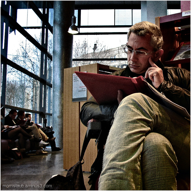 Man reading in a library.