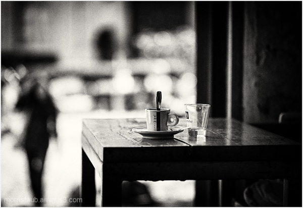 Cafe table scene with cup and glass.