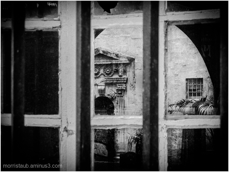 Old building shot through window.