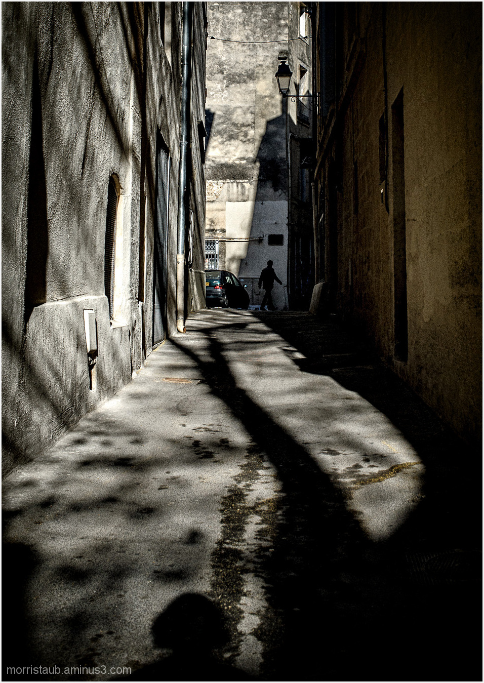 Old street in Montpellier with strong shadow.
