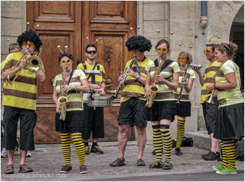 Musicians on the street dressed like bees.