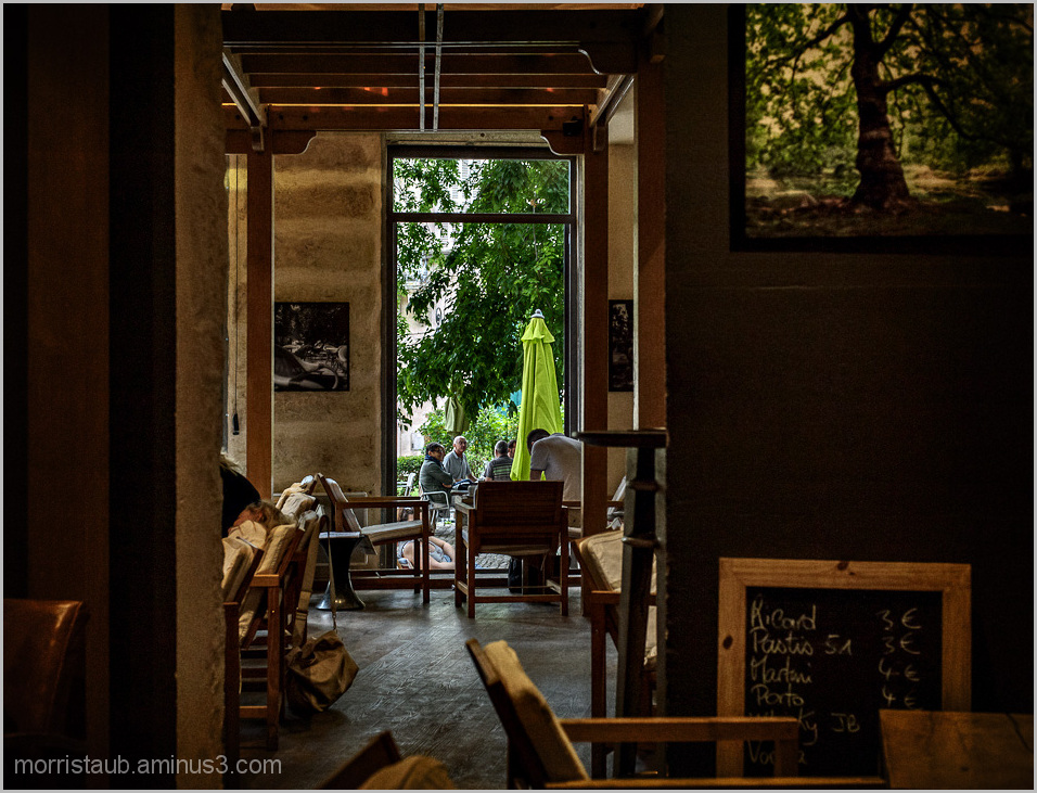 Friends having coffee, talking on a cafe terrace.
