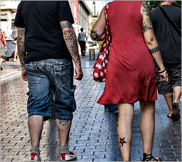 Couple with lots of tattoo's...