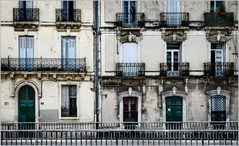 A row of old apartment buildings in France.