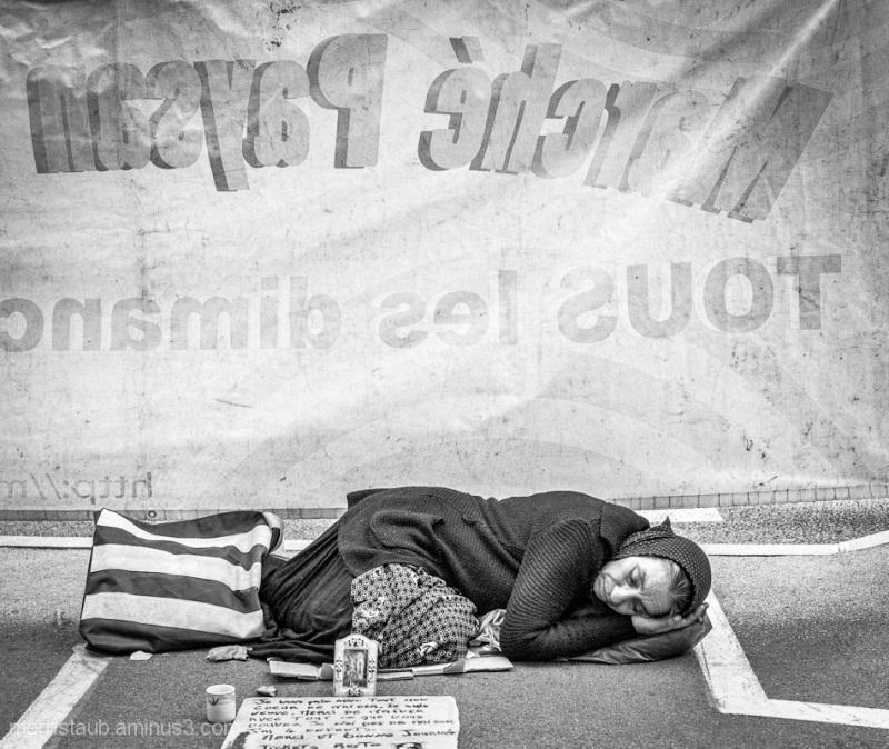 Woman who begs sleeping in the street