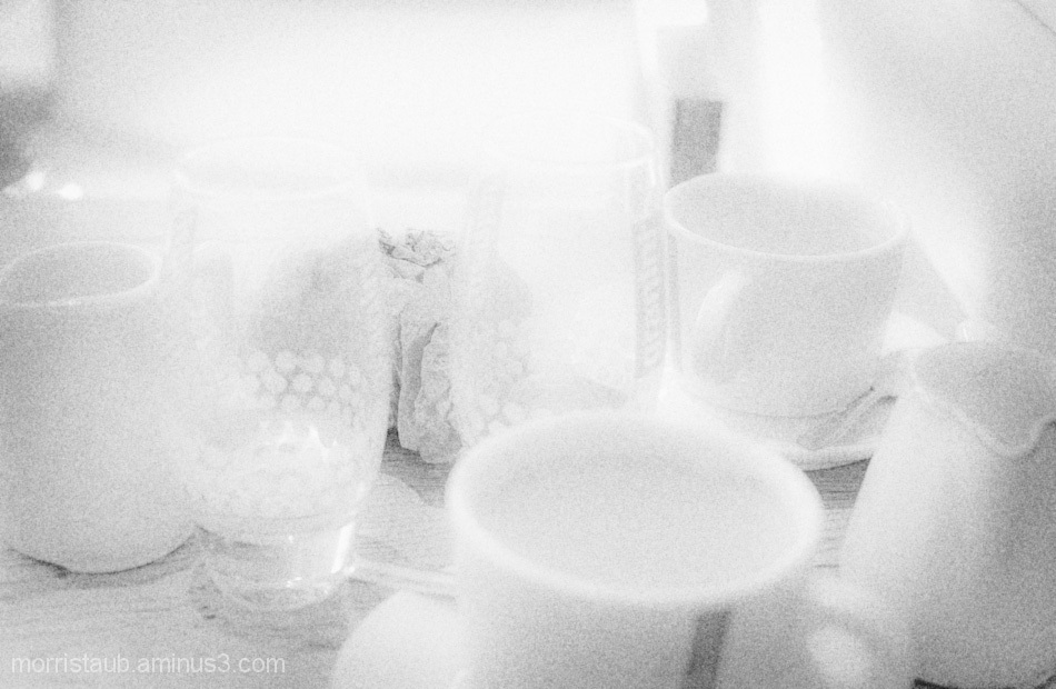 Coffee mugs, water glasses, in a french cafe.