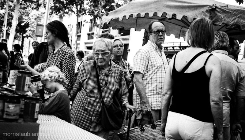 Shoppers at an outdoor market in France.