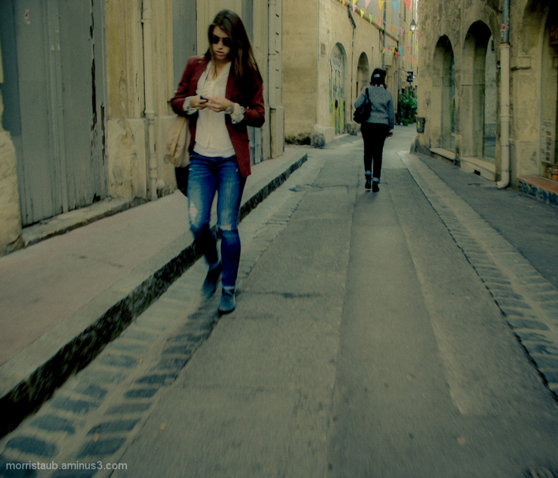 Woman walking and texting.