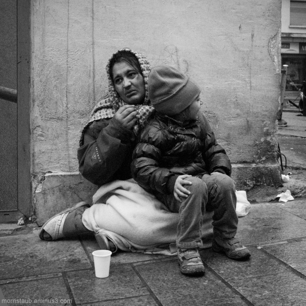 Woman with a child begging for money.