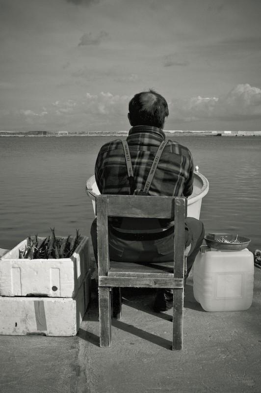 Fisherman: preparing bait
