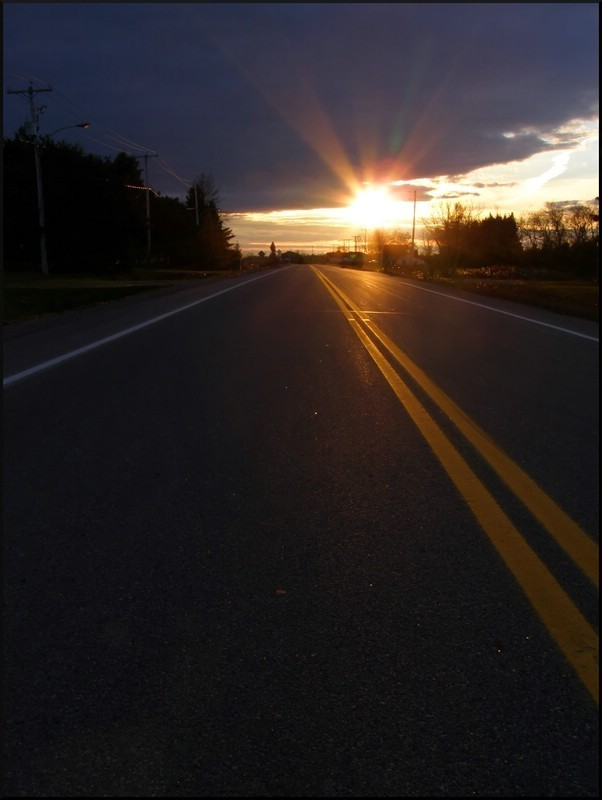 sunset of a straight road
