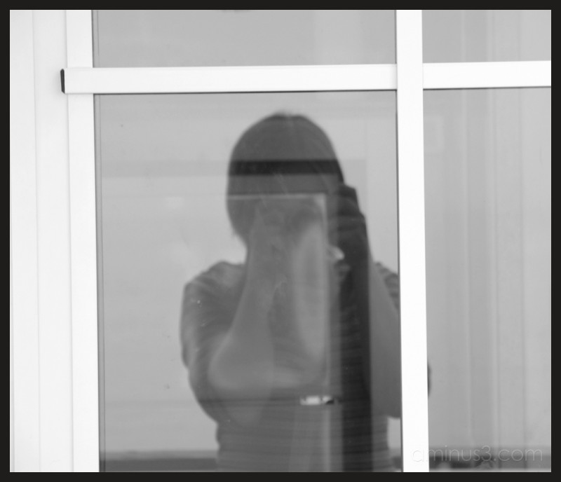 b&w portrait pola istria glass door