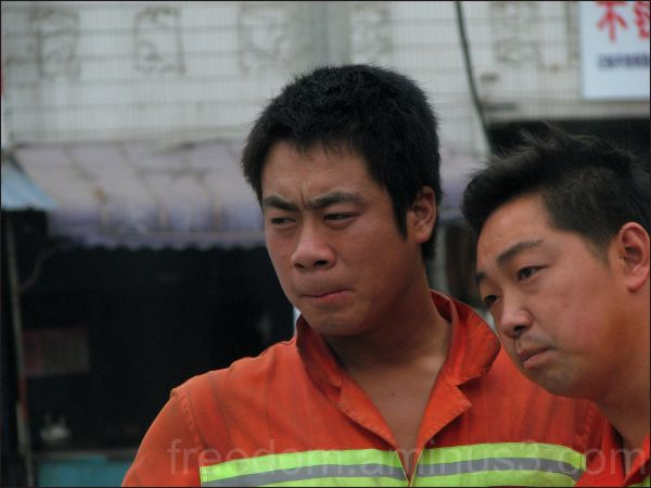 chinese construction workers looking at something
