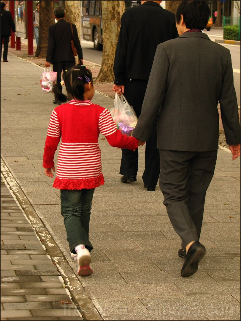 grandchild walking in step in china pink pigtails