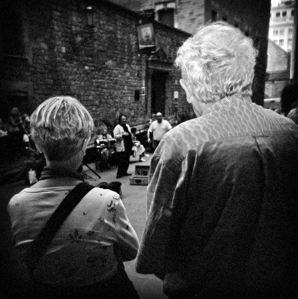 Looking at street singers.