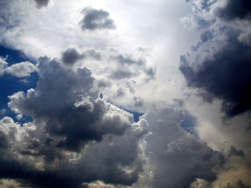 Dark clouds & a blue sky