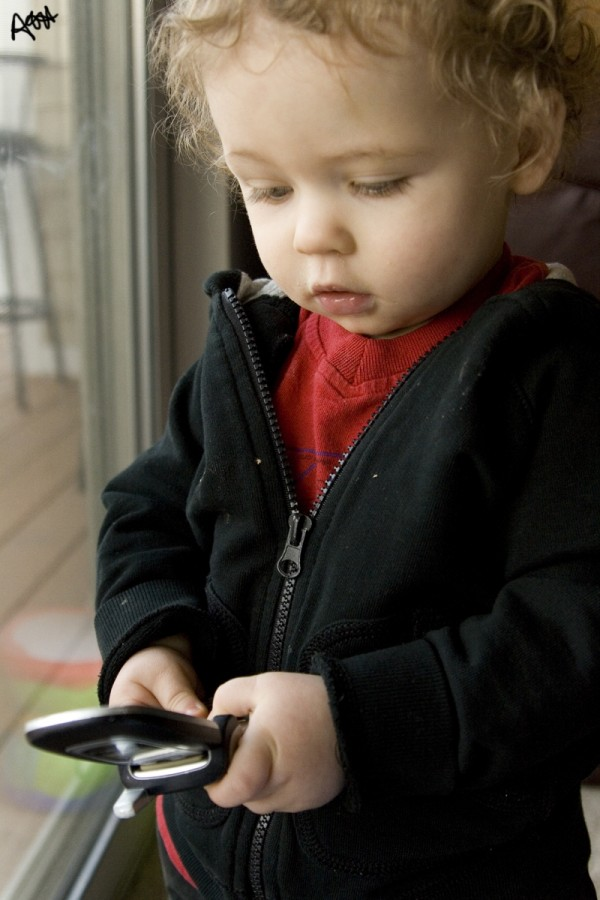 baby plays with cell phone