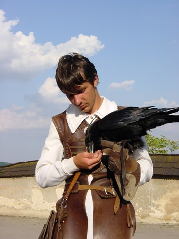 Young man with a crow