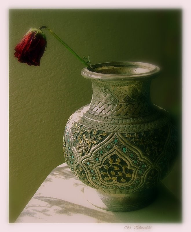 Dried rose and pot