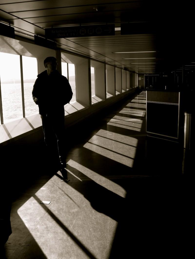 man on ferry shadow