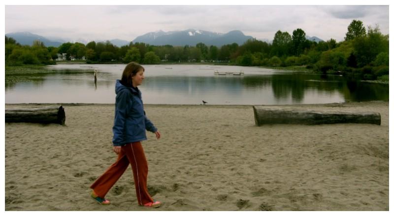 walking across the scene beach mountain