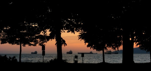tankers at anchor sunset