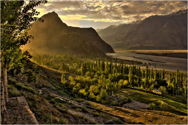 sunset over a village in skardu