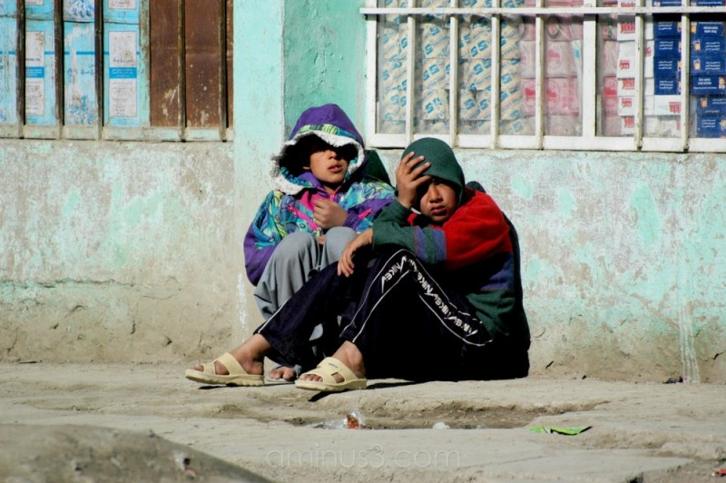 boys crouched on the road side, Taimani